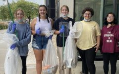 Photo of Green Team members picking up trash in the Burke parking lot after school. Photo courtesy of @burke_greenteam Instagram page.