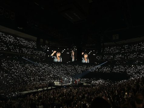 On September 22 Harry Styles speaks to the crowd before performing Fine Line at the Xcel Energy Center in Saint Paul, Minnesota. Photo by Carly Wilson